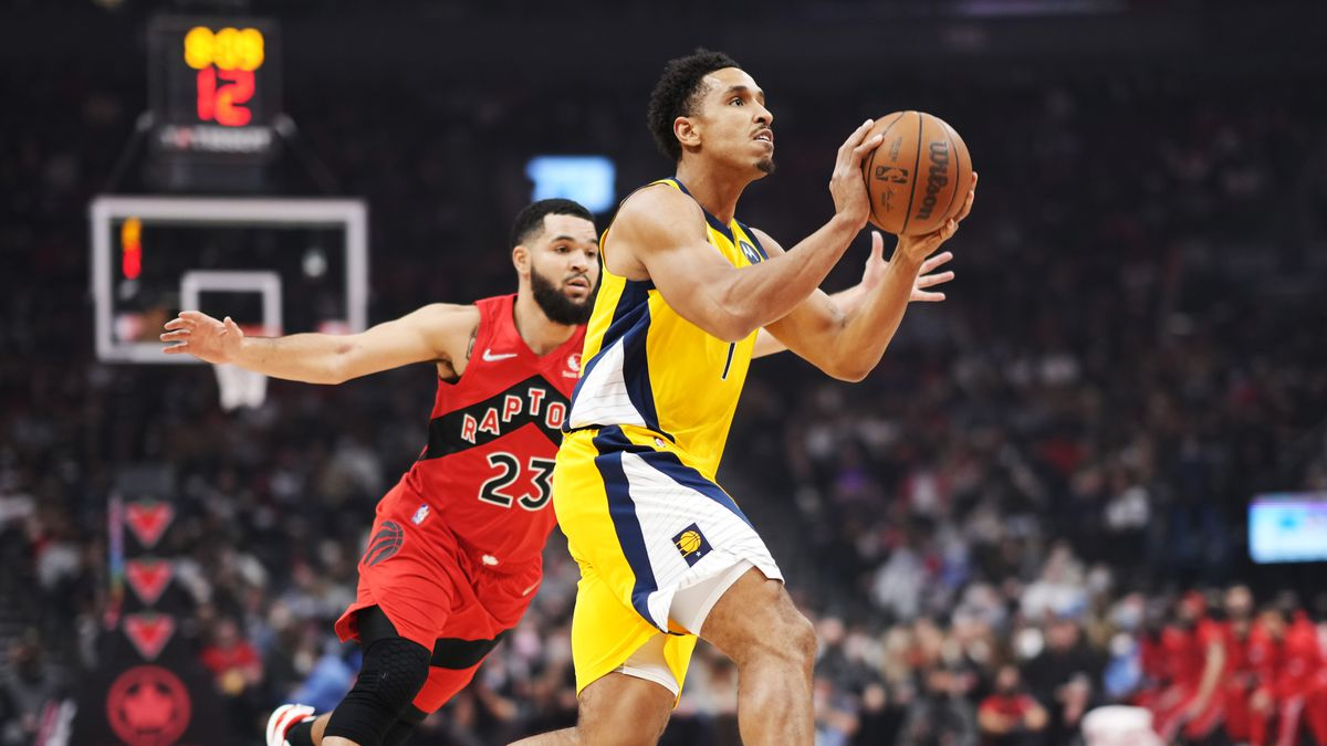 Malcolm Brogdon #7 of the Indiana Pacers goes to the basket against Fred VanVleet #23 of the Toronto Raptors during the first half of the basketball game at Scotiabank Arena on October 4, 2021 in Toronto, Canada.