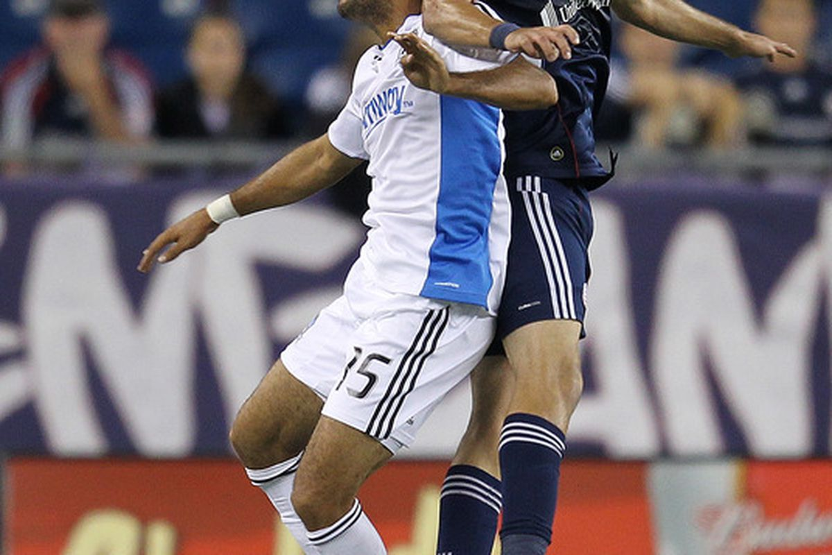 FOXBORO, MA - OCTOBER 8:  Monsef Zerka #19 of the New England Revolution battles Justin Morrow #15 of the San Jose Earthquakes in the second half at Gillette Stadium on October 8, 2011 in Foxboro, Massachusetts. (Photo by Jim Rogash/Getty Images)