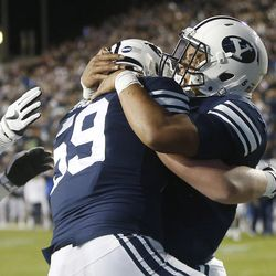 BYU running back Ula Tolutau (5) celebrates his touchdown in Provo on Friday, Oct. 6, 2017.