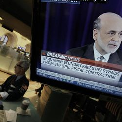 FILE - In this Thursday, Sept. 13, 2012 file photo, Specialist David Pologruto works at his post on the floor of the New York Stock Exchange, as Federal Reserve Chairman Ben Bernanke holds a news conference in Washington, Thursday, Sept. 13, 2012. No sooner did the Federal Reserve unveil a bold plan to juice the U.S. economy than it dangled the prospect of doing even more. Investors celebrated by sending stock prices jumping. Economists were less impressed. Many wonder how much the Fed's action would help.