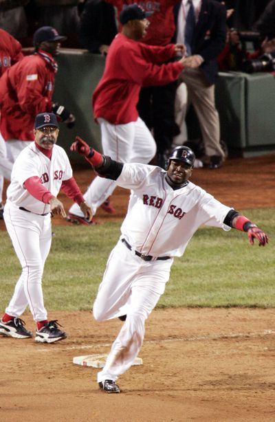 Boston Red Sox's David Ortiz rounds first after hitting a ga