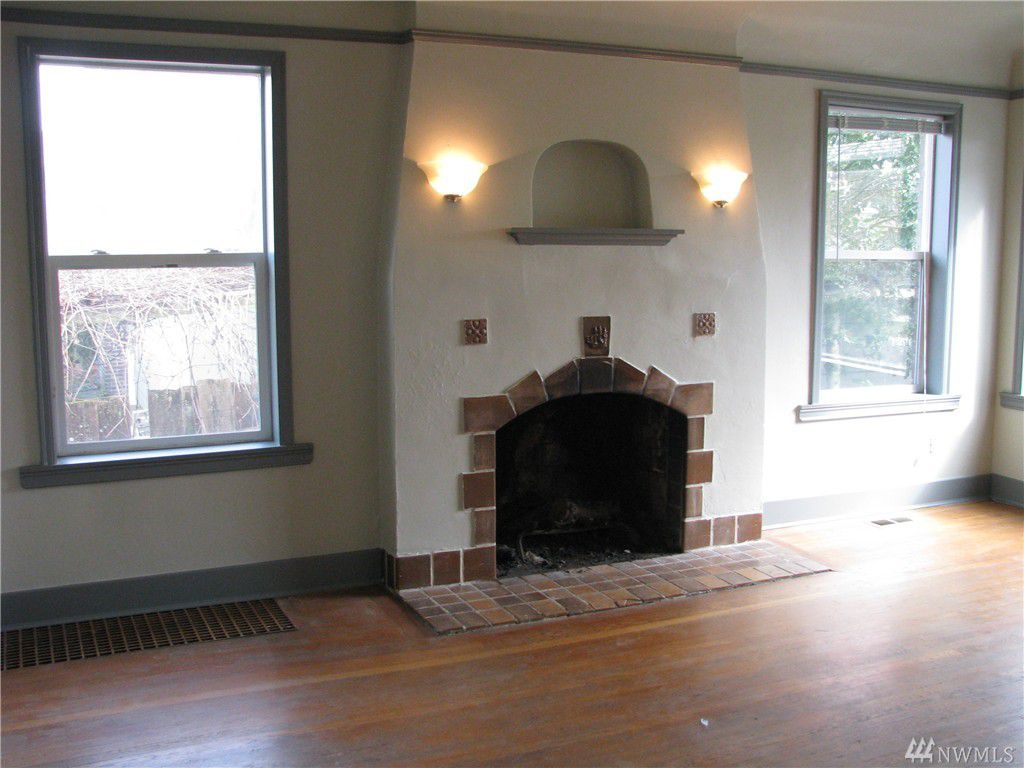 A Spanish-inspired fireplace, smooth white stone with a recessed shelf on the top
