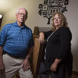 Frank Arnold Horton and his daughter, Suzanne Rengers, both scammed by their tax preparer and financial manager, pose for a photo at Rengers' home in West Jordan on Tuesday, Sept. 27, 2016.