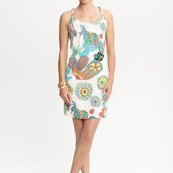 "<a href=""http://bananarepublic.gap.com/browse/product.do?cid=37745&vid=1&pid=905650""> Trina Turk for Banana Republic Crazy Botanical twist strap dress</a>, $130 bananarepublic.com"