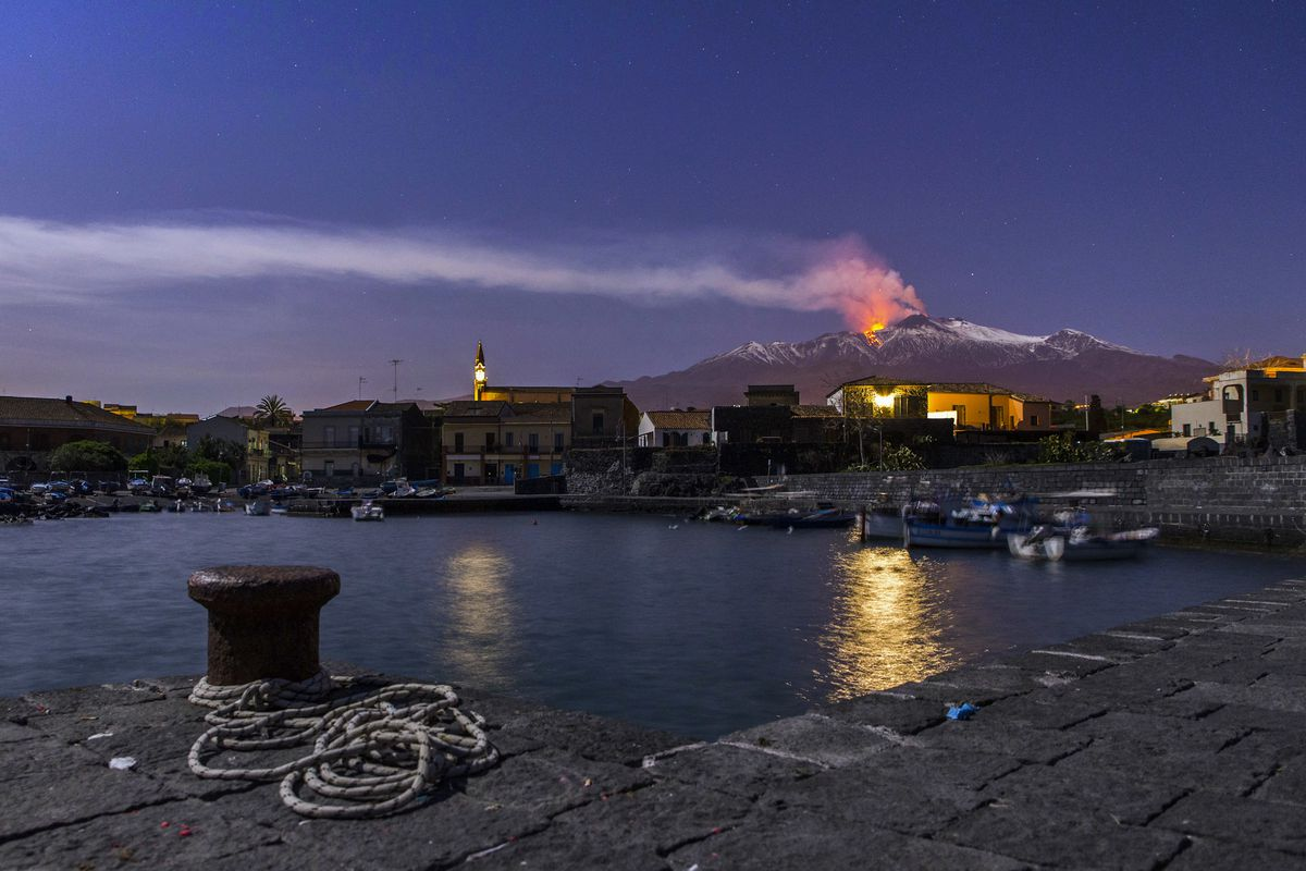 FILE - In this April 11, 2017, file photo, snow-covered Mount Etna, Europe's most active volcano, spews lava during an eruption seen from the Sicilian village of Pozzillo, Italy. Mount Etna is a very active volcano, where eruptions of smoke and sometimes