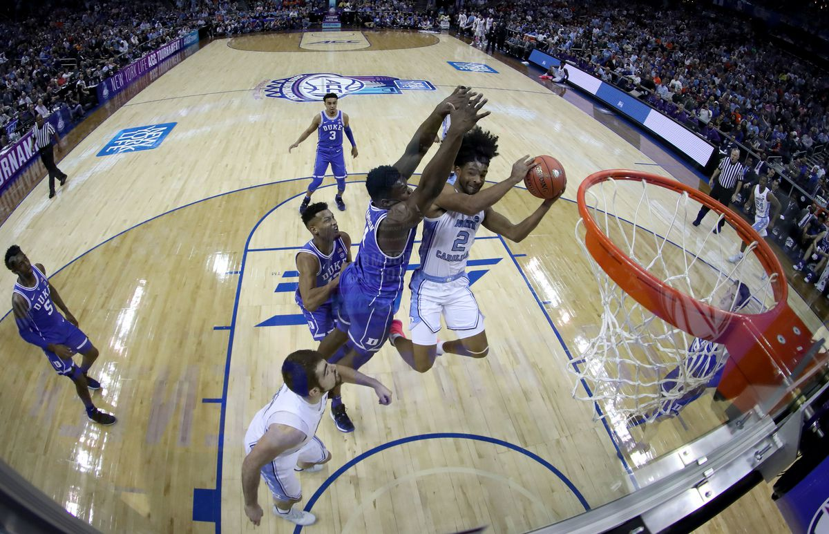 Coby White #2 of the North Carolina Tar Heels drives to the basket against Zion Williamson #1 of the Duke Blue Devils during their game in the semifinals of the 2019 Men's ACC Basketball Tournament at Spectrum Center on March 15, 2019 in Charlotte, North