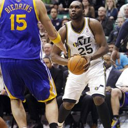 Utah Jazz center Al Jefferson (25) sets to put up a shot over Golden State's #15 Andris Biedrins as the Utah Jazz and the Golden State Warriors play Friday, April 6, 2012 in Salt Lake City. Jazz won 104-98.