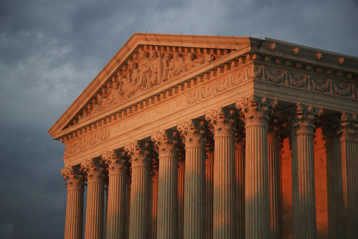 The Supreme Court building in Washington, D.C. at sunset
