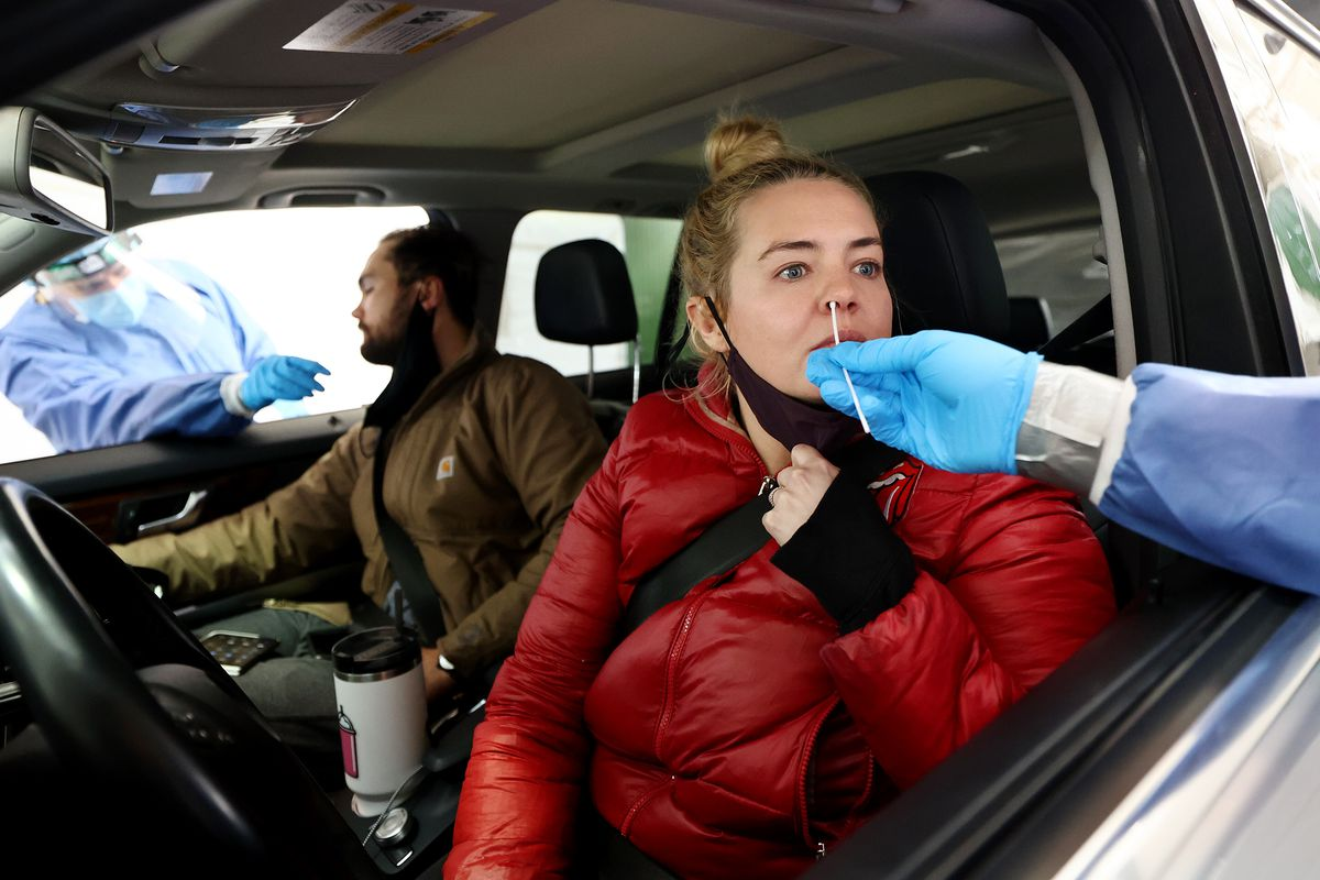 Christopher Benassi and Pollyanna McNeil receive COVID-19 tests at the Utah State Fairpark in Salt Lake City on Friday, Feb. 26, 2021.