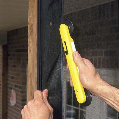 Man Installs New Screening For Porch Screen
