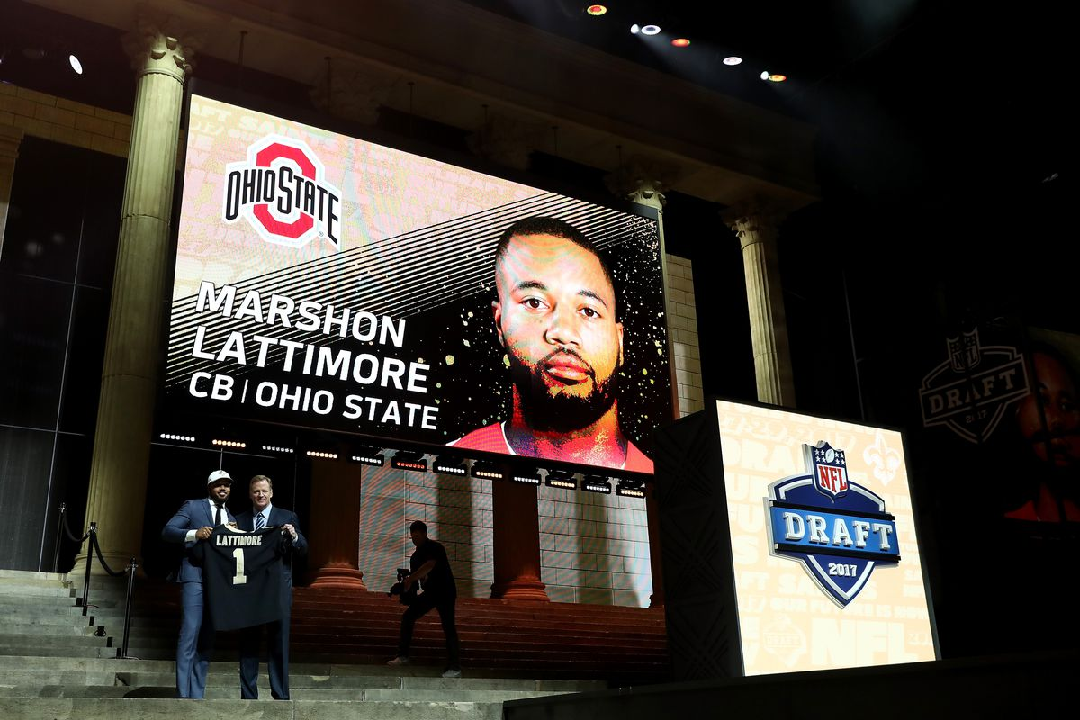 PHILADELPHIA, PA - New Orleans Saints cornerback Marshon Lattimore receives his jersey after being drafted with the eleventh overall pick at the 2017 NFL Draft festival at the Philadelphia Museum of Art.