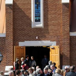 People greet on another following the memorial service for Deedee Corradini at Wasatch Presbyterian Church in Salt Lake City, Monday, March 9, 2015.