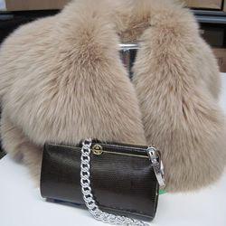 Fur capelet, $150; faux silver bracelet, $35; Ralph Lauren faux silver link chain, $85; and vintage Gucci brown clutch, $450