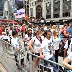 <em>Image via Getty</em><br /><br />More than 1,000 fans stood in line at Times Square on Saturday, July 23rd to walk in the largest runway show ever.