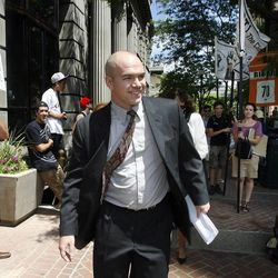 Tim DeChristopher walks past supporters as he nears the federal courthouse in Salt Lake City, Tuesday, July 26, 2011. DeChristopher interfered with an oil and gas lease auction in 2008.