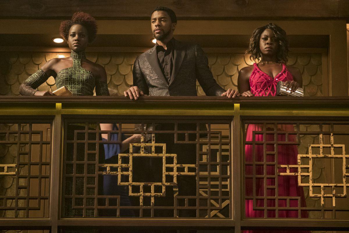 Nakia (Lupita Nyong'o) and Okoye (Danai Gurira) flank T'Challa (Chadwick Boseman) in Black Panther.