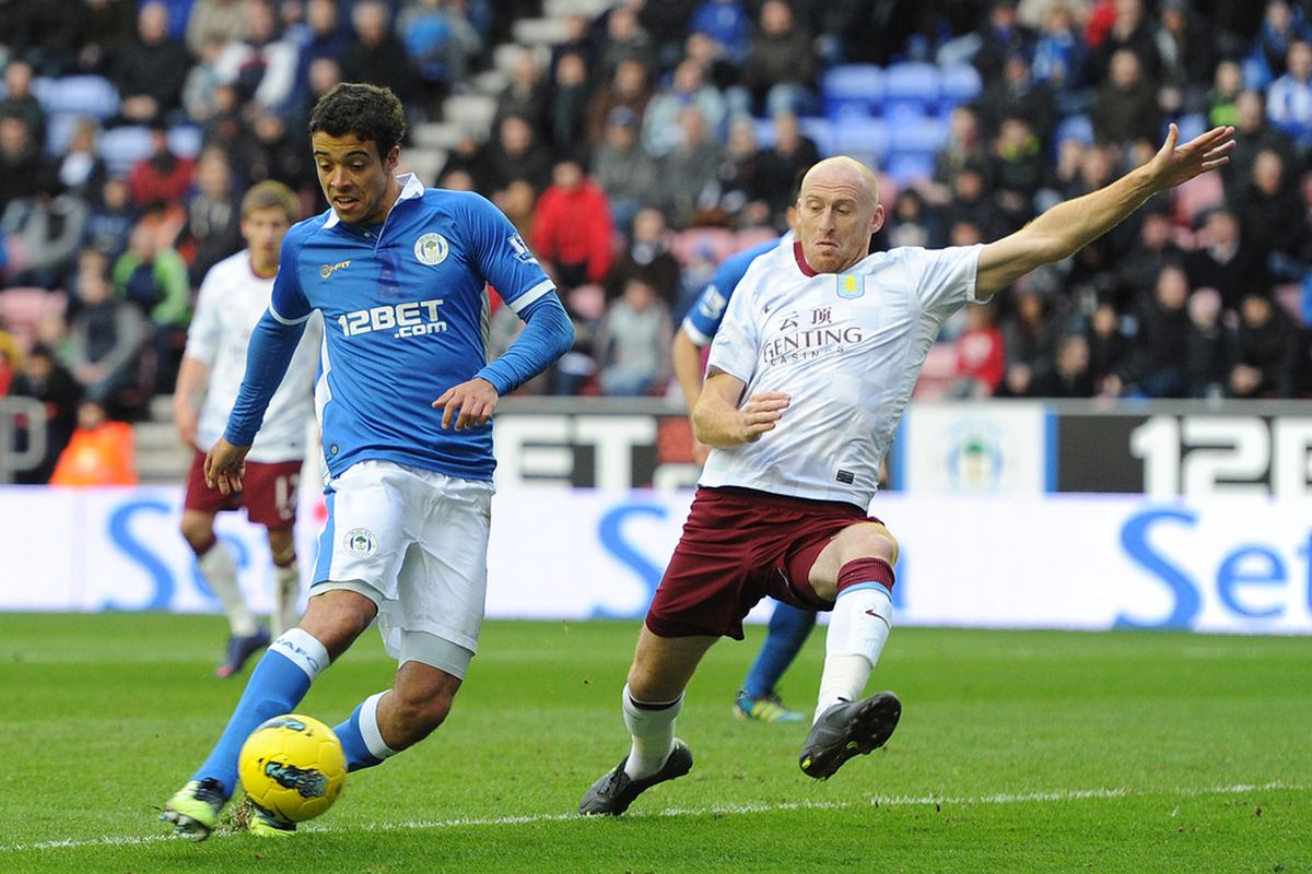 Franco Di Santo of Wigan Athletic in action with James Collins of Aston Villa during the Barclays Premier League match between Wigan Athletic and Aston Villa at DW Stadium.