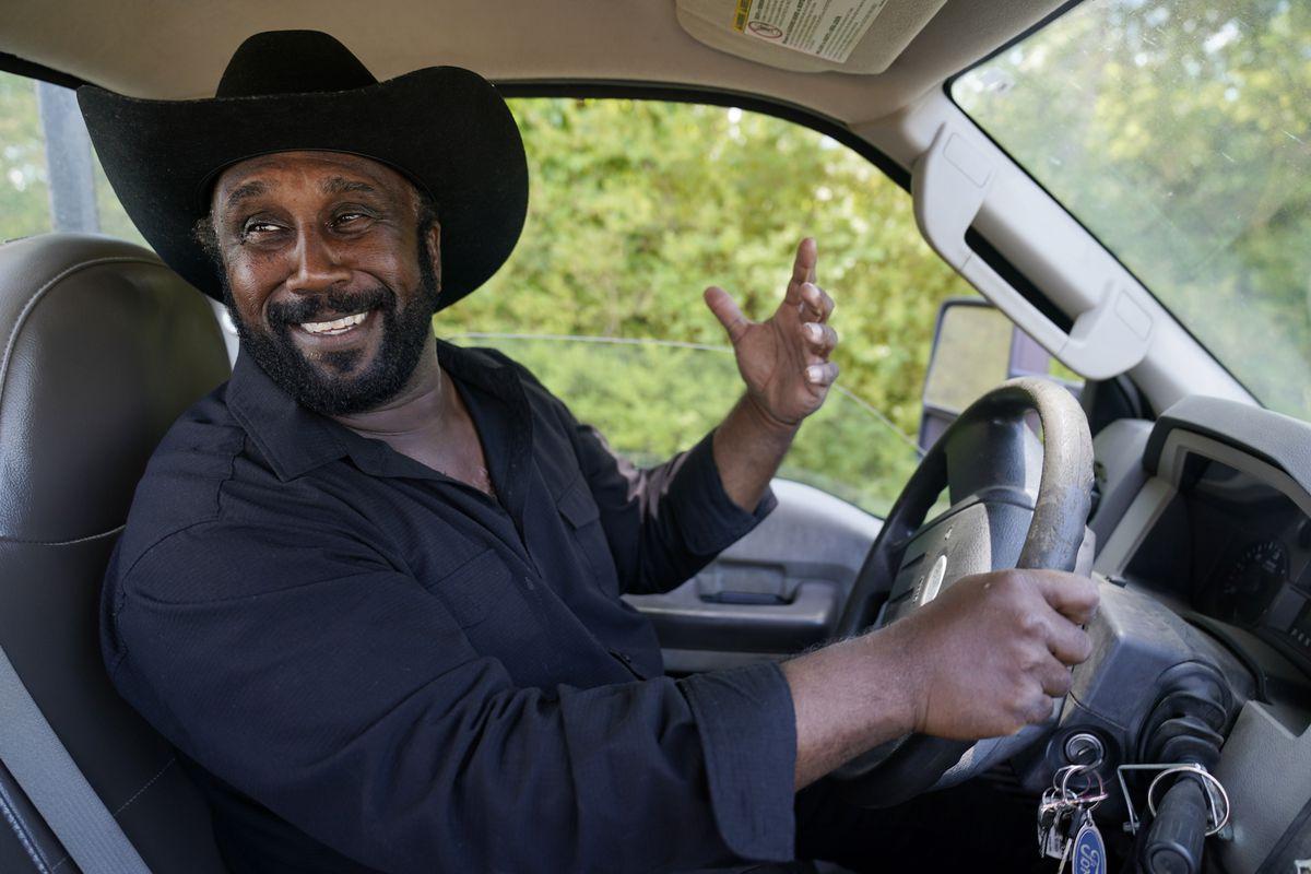 John Boyd Jr. smiles as he drives his truck on his farm in Boydton, Va.