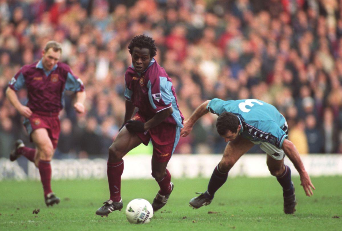 Samassi Abou of West Ham United takes on Murtaz Shelia of Manchester City