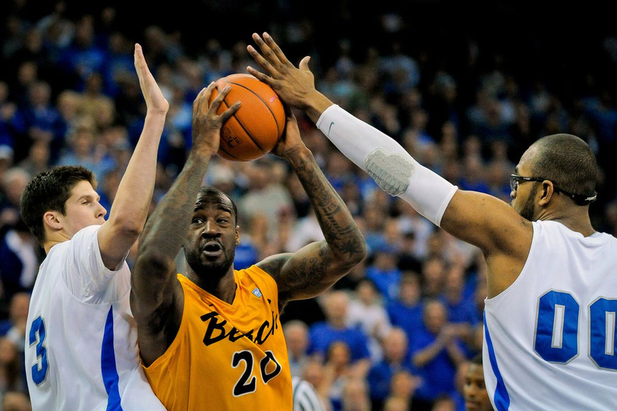 OMAHA, NE - FEBRUARY 18: T.J. Robinson #20 of the Long Beach State 49ers splits Doug McDermott #3 and Gregory Echenique #0 of the Creighton Bluejays at CenturyLink Center February 18, 2012 in Omaha, Nebraska.  (Photo by Eric Francis/Getty Images)