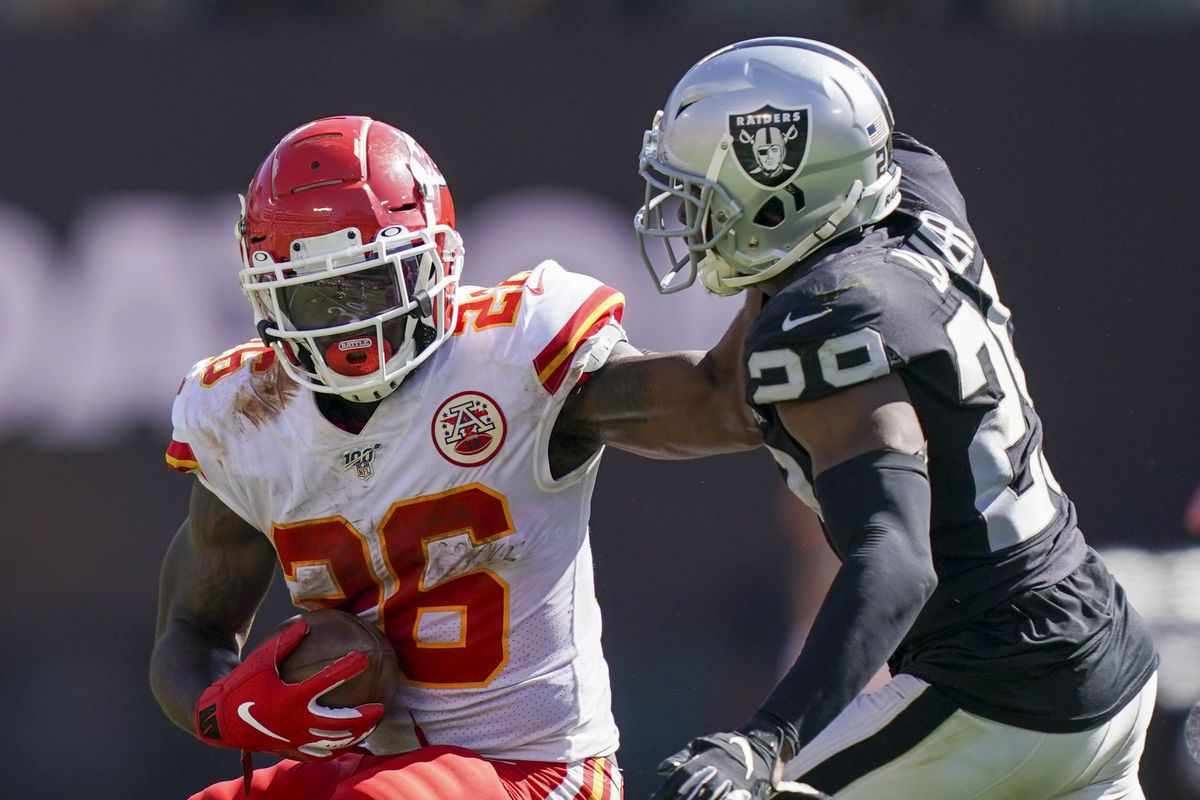 Kansas City Chiefs running back Damien Williams is defended by Oakland Raiders safety Lamarcus Joyner during the third quarter at Oakland Coliseum.