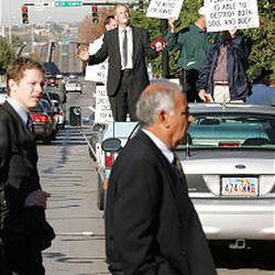 Street preacher Billy Elmquist of Minnesota stands in the back of a truck.