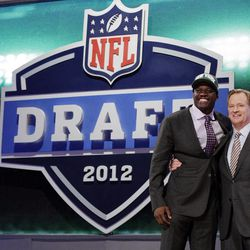 Georgia Tech wide receiver Stephen HIll, left, poses for photographs with NFL Commissioner Roger Goodell after being selected 43rd overall by the New York Jets in the second round of the NFL football draft at Radio City Music Hall, Friday, April 27, 2012, in New York.