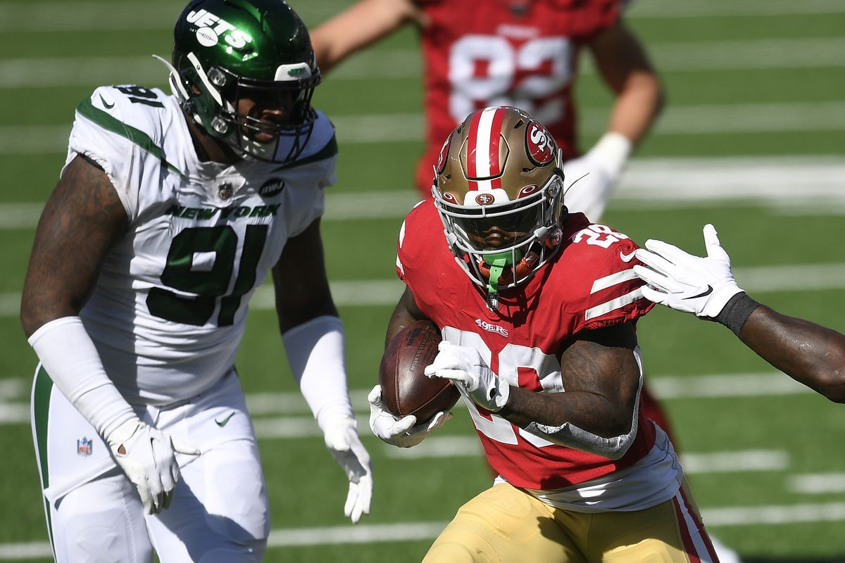 Jerick McKinnon #28 of the San Francisco 49ers carries the ball as John Franklin-Myers #91 of the New York Jets defends during the second half at MetLife Stadium on September 20, 2020 in East Rutherford, New Jersey.