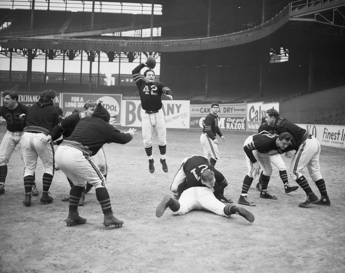 Sid Luckman Jumping in Air to Pass Ball