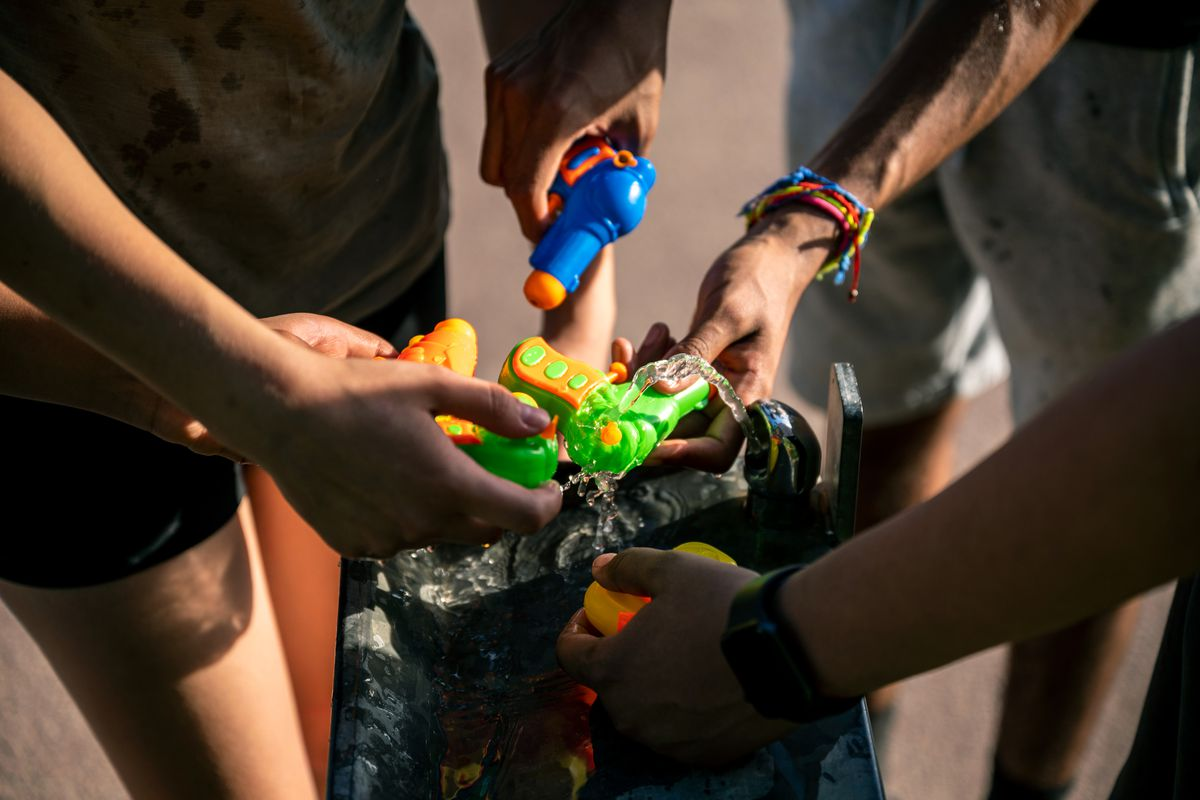 A group of teens took part in a water gun fight on a hot day, May 27, 2021.