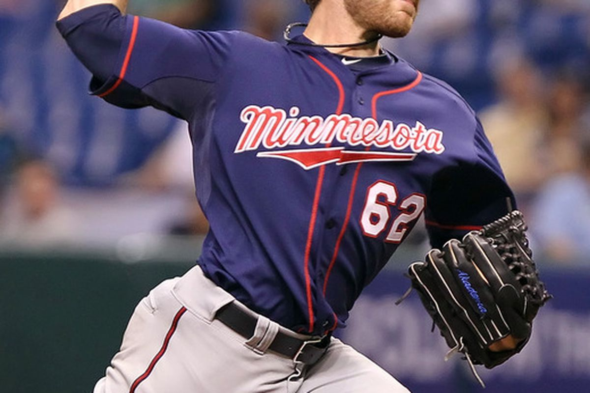 April 20, 2012; St. Petersburg, FL, USA; Minnesota Twins starting pitcher Liam Hendriks (62) throws a pitch in the second inning against the Tampa Bay Rays at Tropicana Field. Mandatory Credit: Kim Klement-US PRESSWIRE