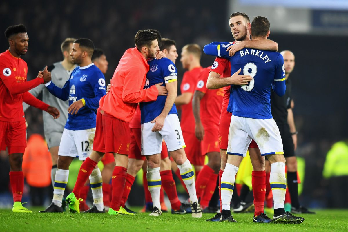 Players from both teams embrace after the Goodison Park derby