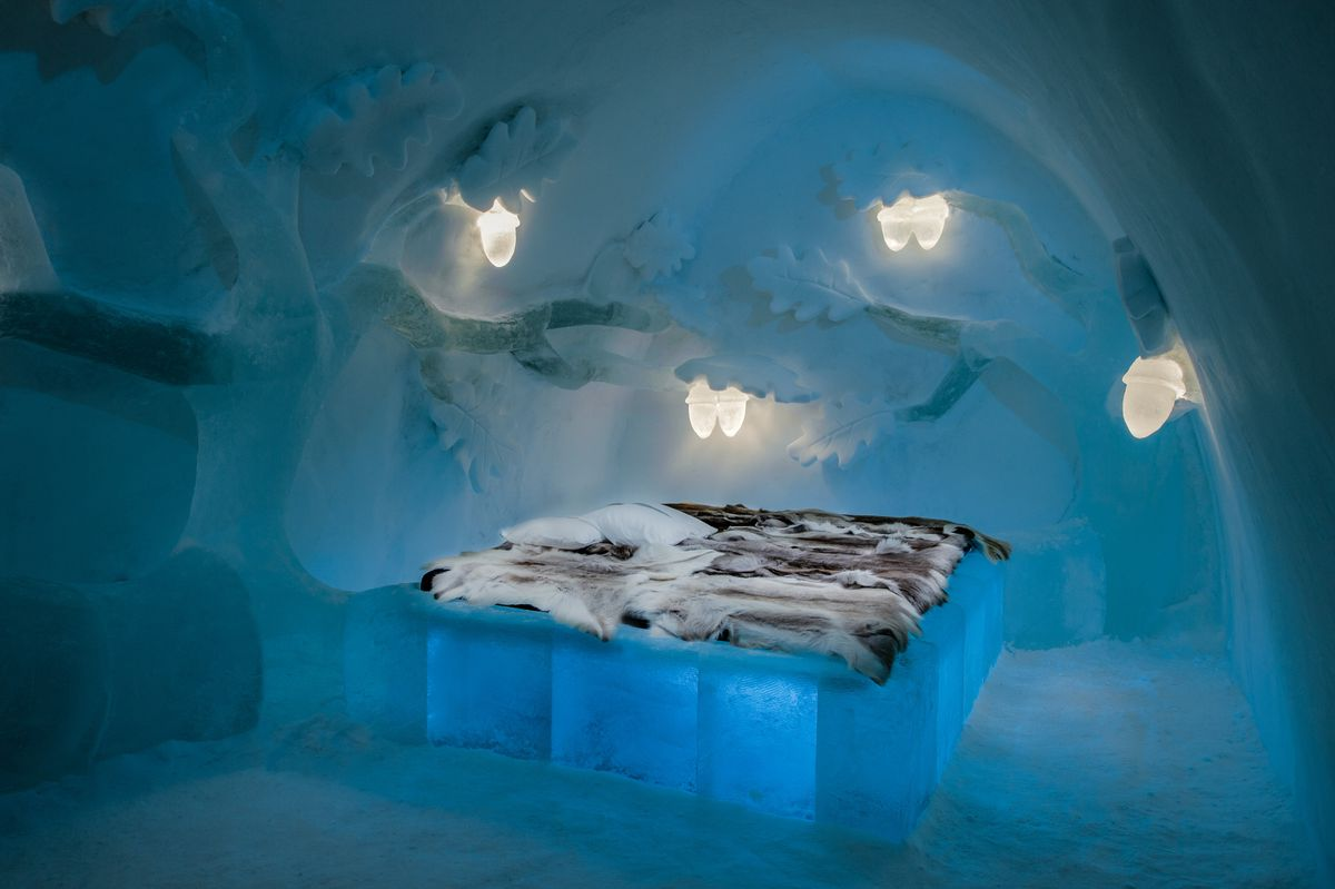 Ice hotel room with fur bedspread