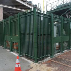 A wide view of the green screens installed at Gate R, in the right field corner
