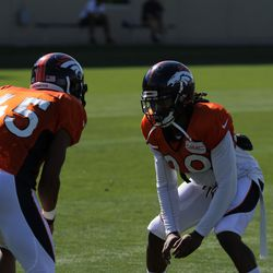Denver Broncos rookie CB John Tidwell (45) looks to get around fellow CB Bradley Roby during drills at training camp.