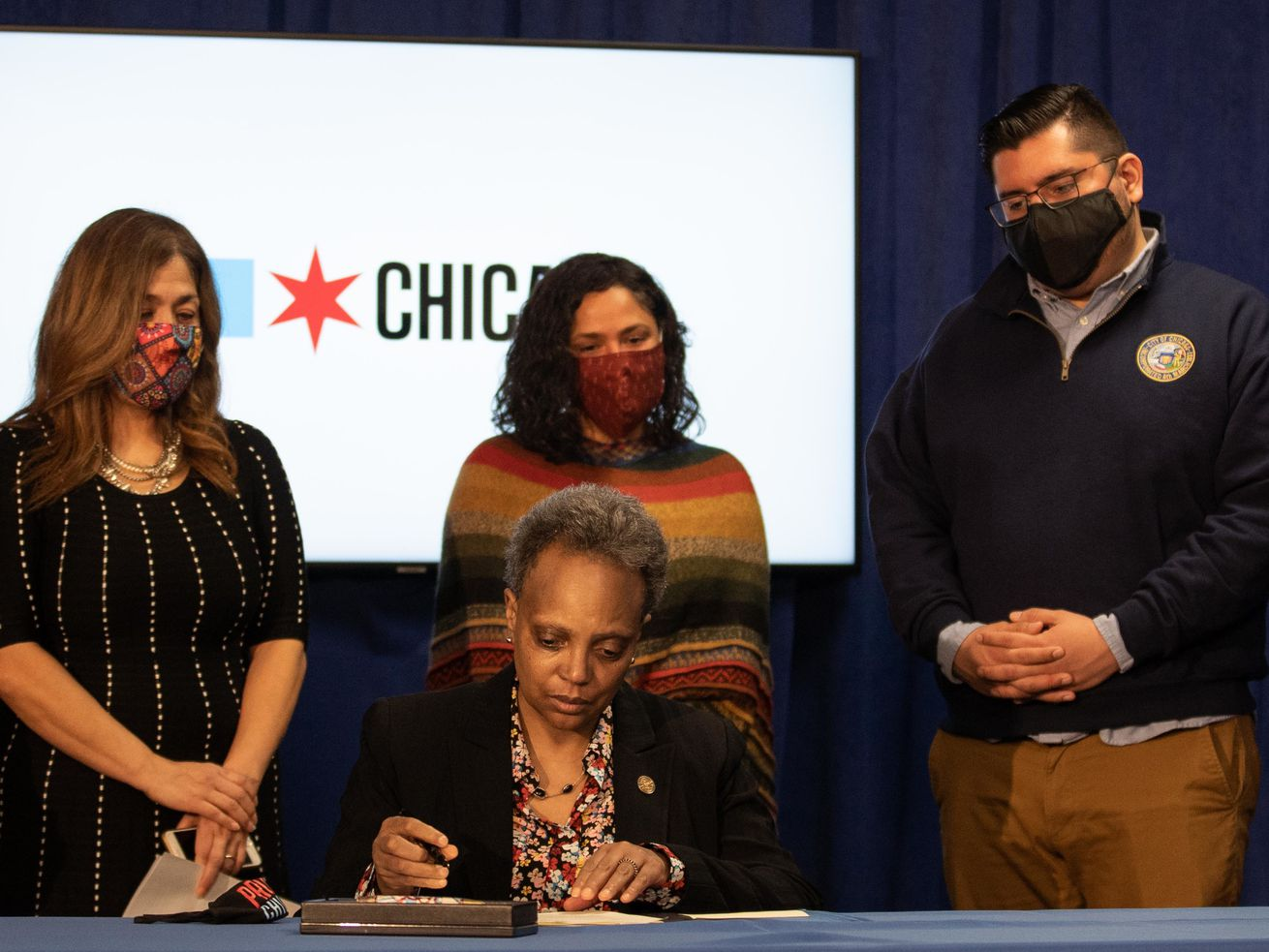Chicago Mayor Lori Lightfoot signs a revised version of the Welcoming City Ordinance at City Hall on Tuesday, Feb. 23, 2021. Joining her were (from left) Instituto del Progreso Latino President and CEO Karina Ayala-Bermejo, Ald. Rossana Rodriguez (33rd) and Ald. Carlos Ramirez-Rosa (35th).