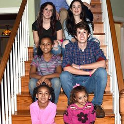 The DeGarmo family — John, Kelly, Brailey, Brody, Gracie, Jace, Kolby and Cassie — pose in their home on Feb. 28.