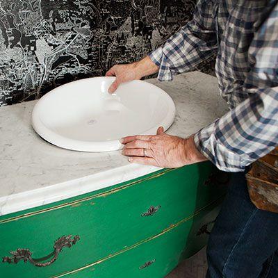 Man Installs Sink Of Bathroom Vanity Dresser
