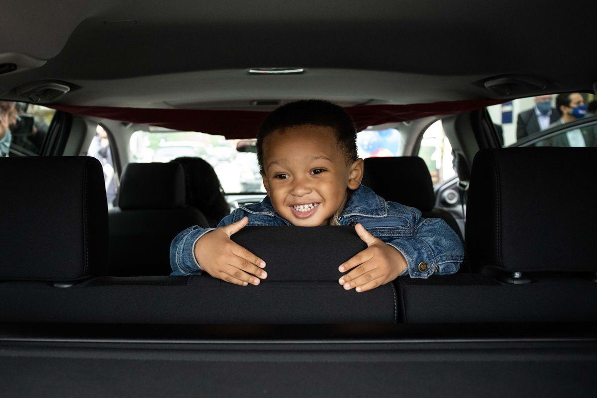 Gabriel Scanlon-Curtis, son of Marine Corps veteran Ah'monie Scanlon, smiles as he sits inside the new 2018 Honda CR-V.