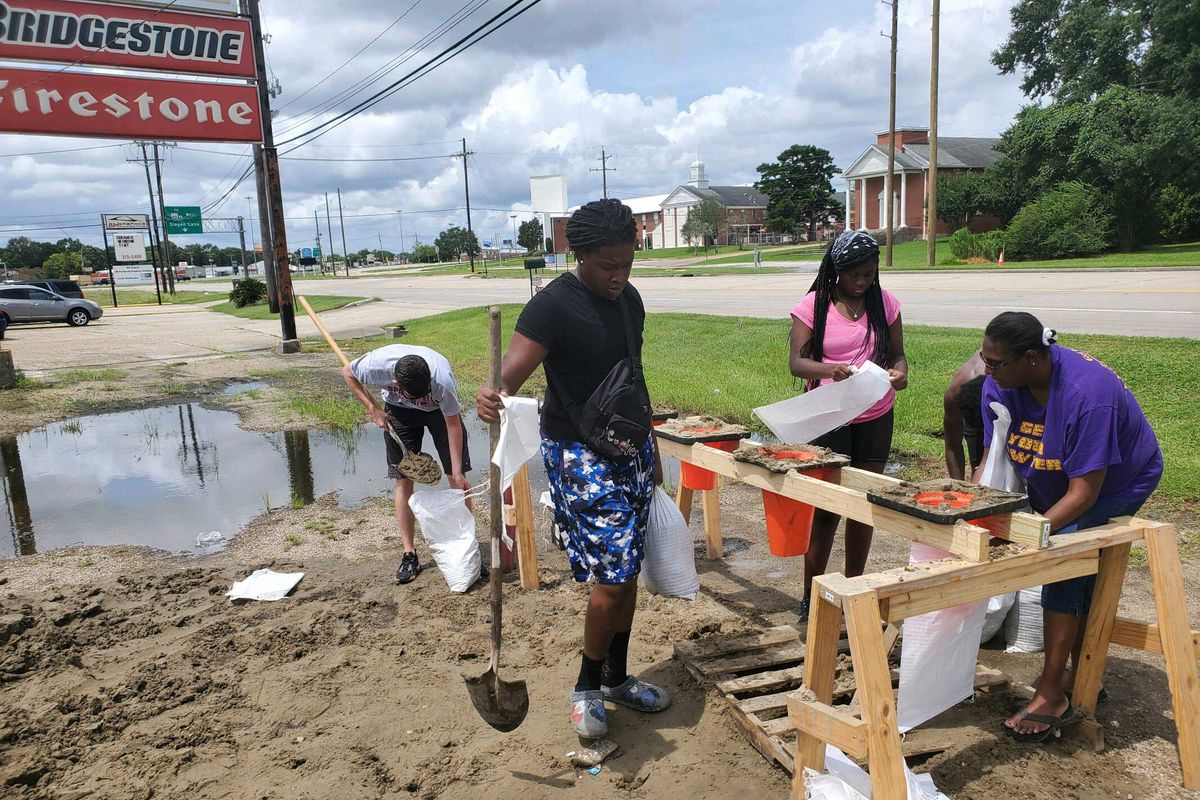 People in Baton Rouge, Louisiana, fill up sand bags as they prepare for Hurricane Ida making landfall.