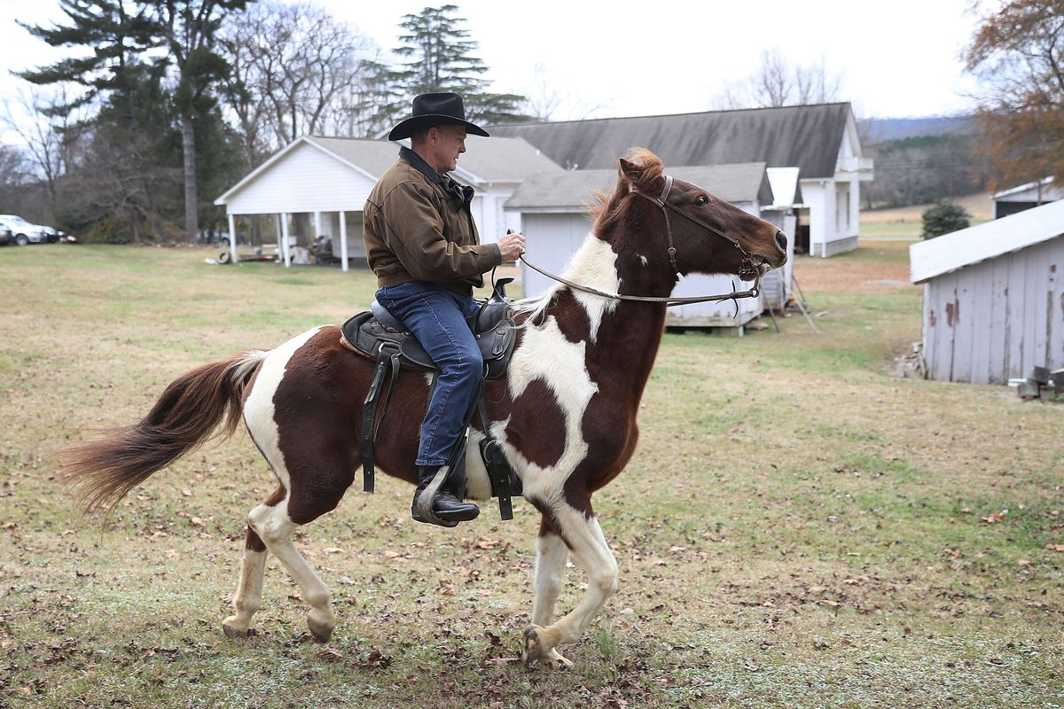 GOP Senate Candidate Judge Roy Moore Arrives At Polling Station To Vote By Horseback