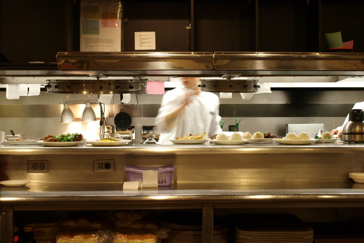 Stock photograph of a chef in a restaurant kitchen