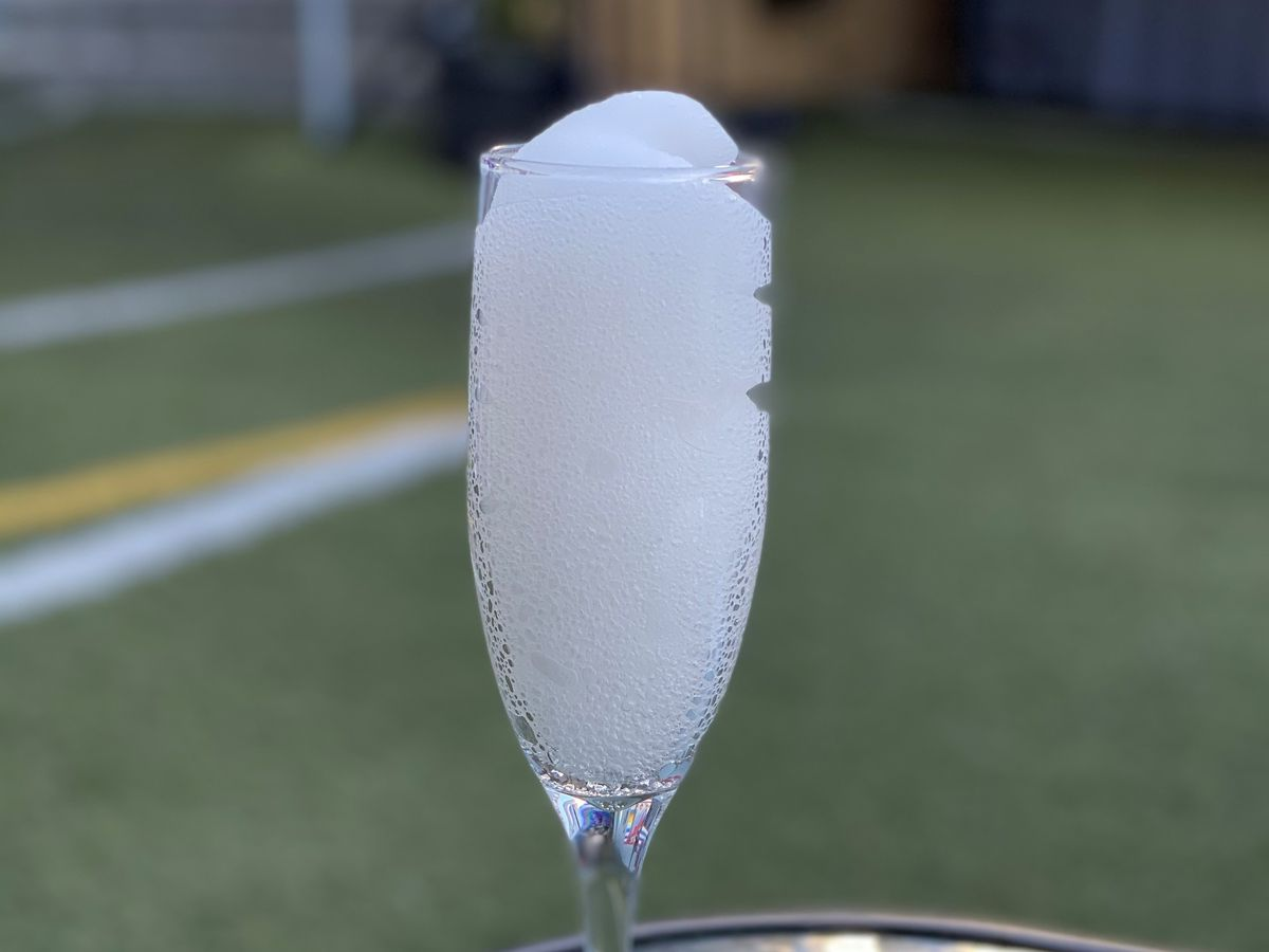 The Grey Goose Peach Frosé in a champagne glass at Rocco's WeHo.