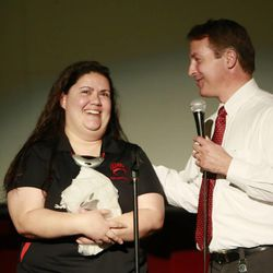 Keri Graybill receives the Granite School District Teacher of the Year from Superintendent Martin Bates at Granite Park Junior High School Friday, May 23, 2014, in Salt Lake City.