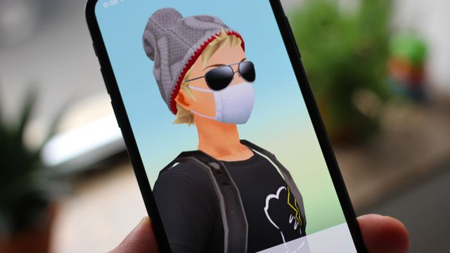 A trainer wears a white facemask in a photo of Pokémon Go on an iPhone
