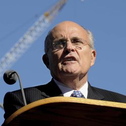 FILE - In this Sept. 11, 2010 file photo, former New York City Mayor Rudolph Giuliani reads a poem during a memorial service commemorating the ninth anniversary of the Sept. 11 terrorist attacks on the World Trade Center in New York. For the first time, elected officials won't be allowed to speak Tuesday, Sept. 11, 2012, at  an occasion that has allowed them a solemn turn in the spotlight, a change made in the name of avoiding politics, but rapped by some as a political move in itself.