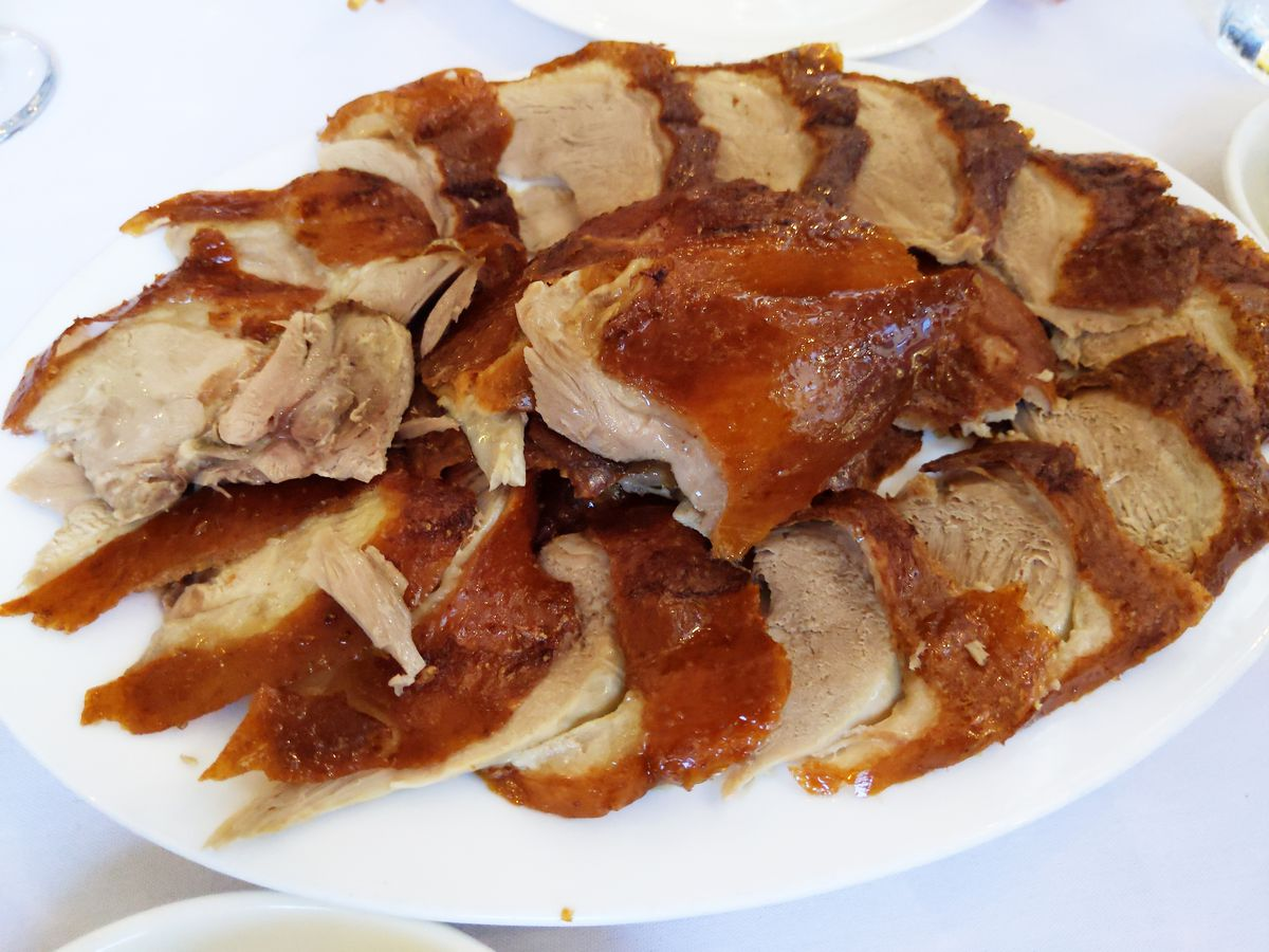 An oblong platter with overlapping slices of brown skinned duck.