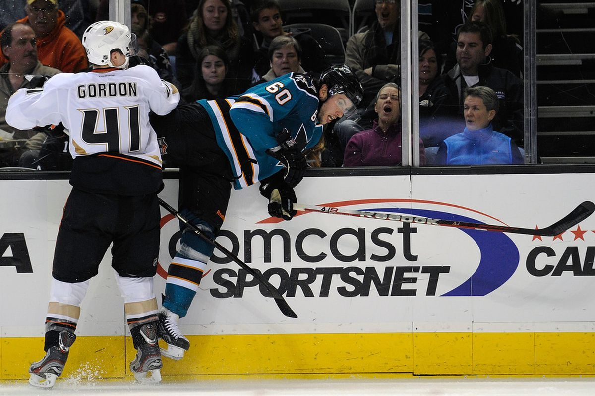 SAN JOSE, CA - DECEMBER 26:  Andrew Gordon #41 of the Anaheim Ducks collides with Jason Demers #60 of the San Jose Sharks at HP Pavilion at San Jose on December 26, 2011 in San Jose, California.  (Photo by Thearon W. Henderson/Getty Images)
