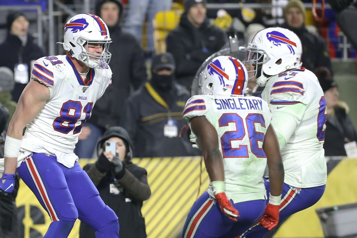Buffalo Bills tight end Tyler Kroft celebrates his touchdown with running back Devin Singletary and offensive guard Quinton Spain against the Pittsburgh Steelers during the fourth quarter at Heinz Field.