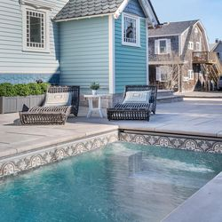 The concrete plunge pool was precast in New Hampshire, trucked in, and craned into place. Its heater can raise the water temperature by 10°F an hour; app control means you can turn it on from a phone on the way home from work. <em>Plunge pool: </em><a class=